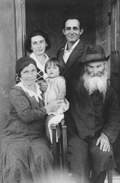 A Jewish family poses for a family photograph outside its home on the eve of Shavuot.  The woman on the left is Ryfka, the sister of Joseph Mordechai Halter.