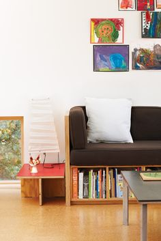 Love this DIY couch! Could do shallow book shelves with inside storage behind, accessible from top (under cushion) for lesser-used items.