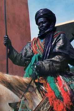 A mounted Hausa warrior in full ceremonial regalia, Nigeria 1974 Vintage Nigeria African Tribes, African Diaspora, Africa Art, West Africa, African Culture, African History, Nigerian Culture, Art Afro, African Royalty