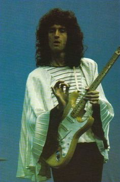 The Zandra Rhodes frock might be bizarre, but Brian May playing a Strat is more so!