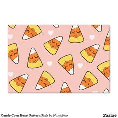 Candy Corn Heart Pattern Pink Wrapping Paper by NamiBear on Zazzle.com. This is a drawing of a candy corn with a smile on her face with hearts around her. It has a pink background.