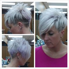 blonde short hairstyle with violet highlights and shaved sides