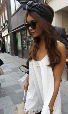 Leather headband, long white tank with lace, black bag and sunglasses