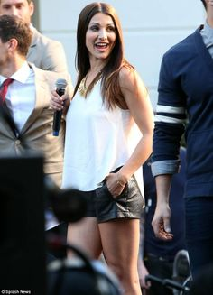Getting a boost: The petite brunette also sported a pair of beige caged shoe boots while showing off her slim legs
