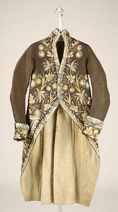 Coat, France, 1780-1790. Brown silk, lavishely embroidered with floral motifs and leafs.