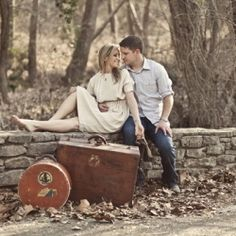 This couple gathered family heirlooms, including their grandparent's vintage suitcases, for their travel-themed engagement session.