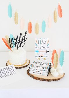 Wild One Tribal 1st Birthday Party | Sweets Table Idea | Custom cake topper, invitation and personalized candy bar wrappers from Sweet Paper Shop | Read about it on our blog!