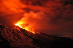 ILLUMINATING THE DARKNESS: Mount Etna erupted in Sicily, Italy, early Monday. (Salvatore Allegra/Associated Press)