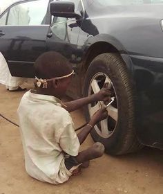 Don't Give Up!! Crippled Boy Who Works As A Vulcanizer (See Photo) - http://www.77evenbusiness.com/dont-give-up-crippled-boy-who-works-as-a-vulcanizer-see-photo/