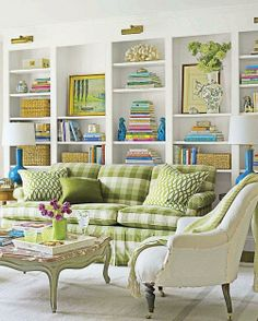 Love this traditional style family room with the lively green checked upholstered couch