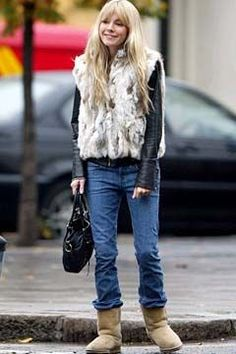 Sienna Miller, pictured here in classic Uggs and the gillet leather combo that would inspire thousands of imitations.