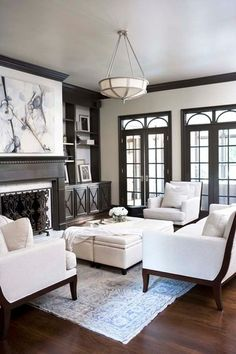 gorgeous dark wood trim is perfect with this two-tone decor | traditional living room by Linda McDougald Design | Postcard from Paris Home via Houzz #oldhouseideas