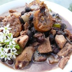 Hmmm ... I have a more intricate version of feijoada (Brazilian Pork and black bean stew), but this is a great weeknight alternative that doesn't require a slow cooker.  Pork and Black Bean Stew - Allrecipes.com