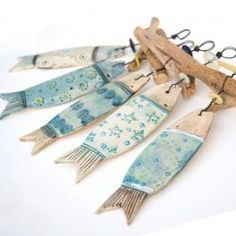 ceramic fish and driftwood hangers by Shirley Vauvelle available at CoastalHome.co.uk