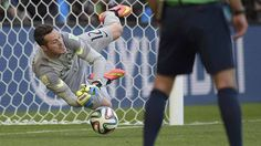 Brazil goalkeeper Julio Cesar saves a penalty in a dramatic shoot-out against Chile.