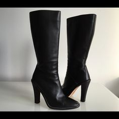 "BALENCIAGA BLACK KNEE HIGH BOOTS WITH ZIP AT SIDE BALENCIAGA BLACK KNEE HIGH BOOTS WITH ZIP AT SIDE, SIZE 37.5, MADE IN ITALY, LEATHER UPPER, SOLE AND LINING, STACKED HEIGHT HEEL 4.5"", BOOTS SHAFT 12"", CIRCUMFERENCE 12.5"", NO SIGNS OF WEAR ABOVE SOLE, IN EXCELLENT CONDITION Balenciaga Shoes Heeled Boots"