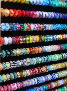 Unique Trollbeads! Oh my It would take me forever to choose for a bracelet from an entire wall full of beads!
