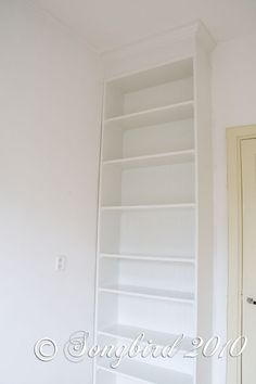 Built in's using Ikea Billy bookshelf!  I MUST do this asap. Crown molding at the top makes it look like a built in
