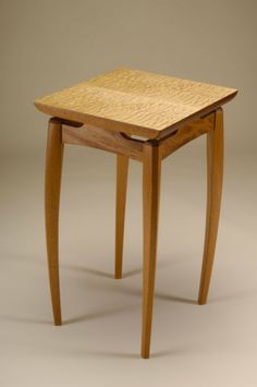 Gently curved legs with floating top by Neal Barrett Woodworking