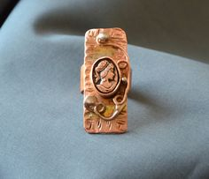Check out this item in my Etsy shop https://www.etsy.com/listing/270052368/copper-cameo-ring-hammered-copper
