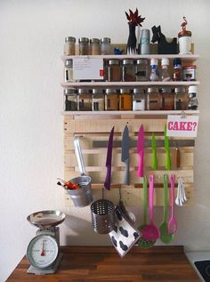 Here, a small shipping pallet offers the perfect foundation for shelves for small bottles, hooks for spoons and cups, and a metallic strip for knives. Get the tutorial at Schon's Imagination »  - GoodHousekeeping.com