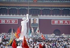 Tiananmen Square (1989) The Goddess of Democracy.  Notice how the statue has been placed facing down Mao.