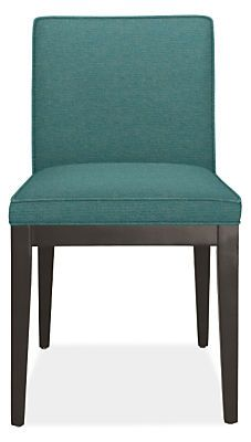The Ansel upholstered chair is a versatile, modern dining chair with crisply tailored lines and a comfortable seat you can relax in long after the meal is over.