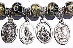 $129 Catholic charm bracelet for wrist size up to *6 inches* with Holy medals from Italy featuring Saints, Jesus Christ, The Blessed Mother, Virgin Mary, Guardian Angel  Black, gold and white Murano glass beads are approx. 1/2 inch in diameter and are .925 sterling silver, bracelet european style closure is marked .925 as well. The 8 medals are oxidized silver from Italy. The beads are chunky - fits 6 inch or smaller wrist!