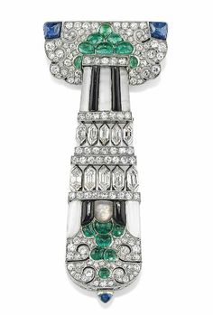 ART DECO EMERALD, SAPPHIRE, ONYX, ROCK CRYSTAL, DIAMOND, GOLD AND PLATINUM BROOCH/WATCH. With French assay marks, numbered, circa 1930.