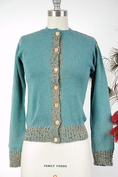 Vintage 1930s or early 1940s cardigan is such a rare and special find. I ove the homemade pieces from the era - they are true one of a kinds, and always in wonderful colors and well detailed. Its a cerulean blue that tested as silk, but I think it may be silk and wool together. The blue ton