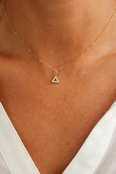 "Dainty triangle pyramid pendant encrusted with tiny cubic zirconias on a dainty diamond cut chain. Perfect for layering! - Closure: Lobster clasp. - Materials: 14K Gold Filled - Measures 15"" + a 2"" ex"