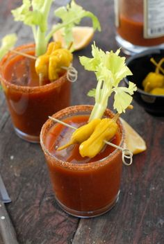 Bloody Mary's.  The glass is rimmed with Bacon Rim Shot (bacon salt) and Pepperoncinis and Celery Stalks used for garnish.
