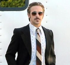 In honor of Movember, take a look at hot celebs including Brad Pitt, Ryan Gosling, and Zac Efron who are sporting their mustaches proudly; see the pic