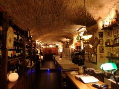 The vaulted brick ceilings of the underground rooms of Osteria dè Poeti give it a warm and cozy atmosphere.