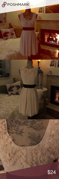 """Vintage inspired dress 👗 Vintage inspired buttercream dress .. 31"""" length 100% polyester ..gently worn 1 time . Classic :). It fits more like a 4-6. Although it says medium. Black band stretches. Charlotte Russe Dresses Midi"""