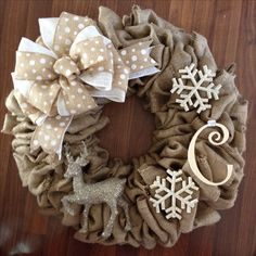 Burlap wreath. Love the reindeer & snowflakes!! Reds & Silvers on burlap