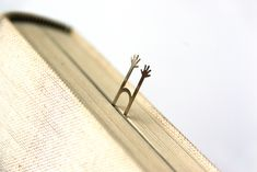 Help Bookmark by lily suh via designboom: http://tinyurl.com/18r . $19 for 5 steel pairs of arms. #Bookmark #Help_Bookmark #Lily_Suh