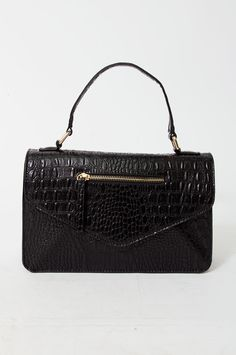 We truly love this classic and luxurious handbag. The bag has a croco-feel structure and features a grab handle, an adjustable cross-body strap, two extra pockets with a gold-tone zip fastening, a press stud closure, a lining and inner pockets. This handbag is a safe bet for a fancy event. By Erbs Denmark.