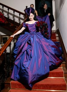 "DITA VON TEESE'S, DUBBED THE QUEEN OF BURLESQUE"" WEDDING DRESS, 17 METERS OF SWISS SILK FAILLE IN A VIOLET HUE RATHER THAN THE TRADITIONAL WHITE COLOR ~ I REALLY LOVE THE COLOR AND THE RISKYNESS OF IT.......:)"