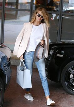 Rosie Huntington-Whiteley topped a white tee and distressed skinny jeans with a blush blazer, pastel blue tote and white sneakers