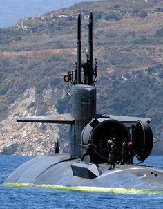 Souda Bay, Crete, Greece (July 19, 2004) - The Los Angeles-class attack submarine USS Dallas (SSN 700) departs Souda Bay harbor following a brief port visit. Dallas is homported in Groton, Conn., and currently on a routine deployment.