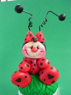 Polymer clay ladybug by claykeepsakes, via Flickr Cute little smiles!