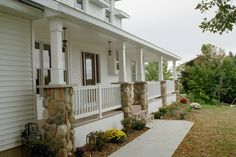 Front Porch columns with stone but would look better if white panel was also in stone