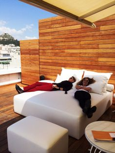Stefania & Natasa #working hard at #NEWHotel, installing new #furniture at Penthouse suite's #terrace! #yeshotels #athens #design #changes #summer