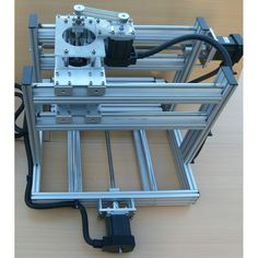 Low Cost, Fast, Robust and Accurate Desktop CNC Machine