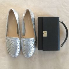 Silver leather cutout flats. Silver leather cutout flats by Nine West. Very comfortable. Brand new.  Clean inside and out. Leather is a slightly muted stressed silver with stars and tiny circle cutouts. Nine West Shoes Flats & Loafers