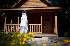 Love this shot of the dress hanging from the cabin.  Love outdoor weddings, especially near Whistler