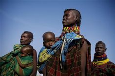 Kenya, 2011: Women wait with their children at a nutrition screening site in the northern pastoralist Turkana District, where over 37 per cent of children suffer from global acute malnutrition. The growing drought crisis in the Horn of Africa, which includes Kenya, Somalia, Ethiopia and Djibouti, is affecting over 10 million people. More than 2 million children need assistance, and 500,000 are at imminent risk of dying.