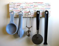 Utensil holder with names of spices decorating it.  Cute!