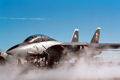 """A specially decorated US Navy (USN) F-14D Tomcat aircraft dubbed the """"Christmas Bird,"""" from Fighter Squadron One Zero Three (VF-103) the ÒJolly RogersÓ prepares for launch from the flight deck of the USN NIMITZ CLASS: Aircraft Carrier USS GEORGE WASHINGTON (CVN 73) while the ship is underway in the Mediterranean Sea."""